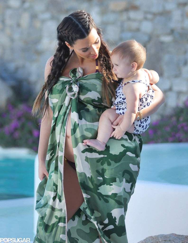 Kim Kardashian carried her niece, Penelope Disick, while on vacation in Mykonos, Greece, in April 2013.