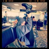 Demi Lovato showed off her stretches while waiting for a flight. Source: Twitter user ddlovato