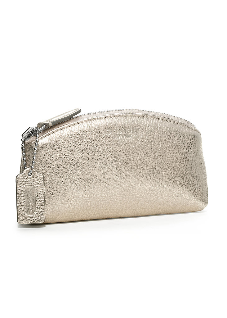 Upgrade her makeup bag with an elegant leather Coach catchall ($48).