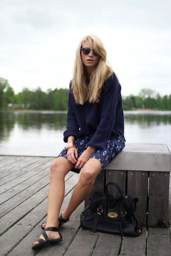 While we love the setting here, we'd gladly pair a printed skirt with an easy knit like this for days in the office.   Source: Lookbook.nu
