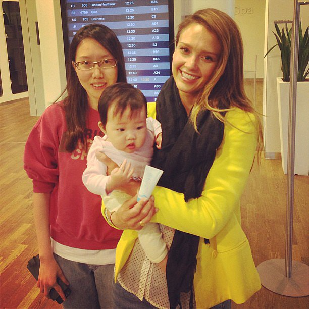 "Jessica Alba posed with a ""happy Honest customer"" and her baby in the airport. Source: Instagram user jessicaalba"