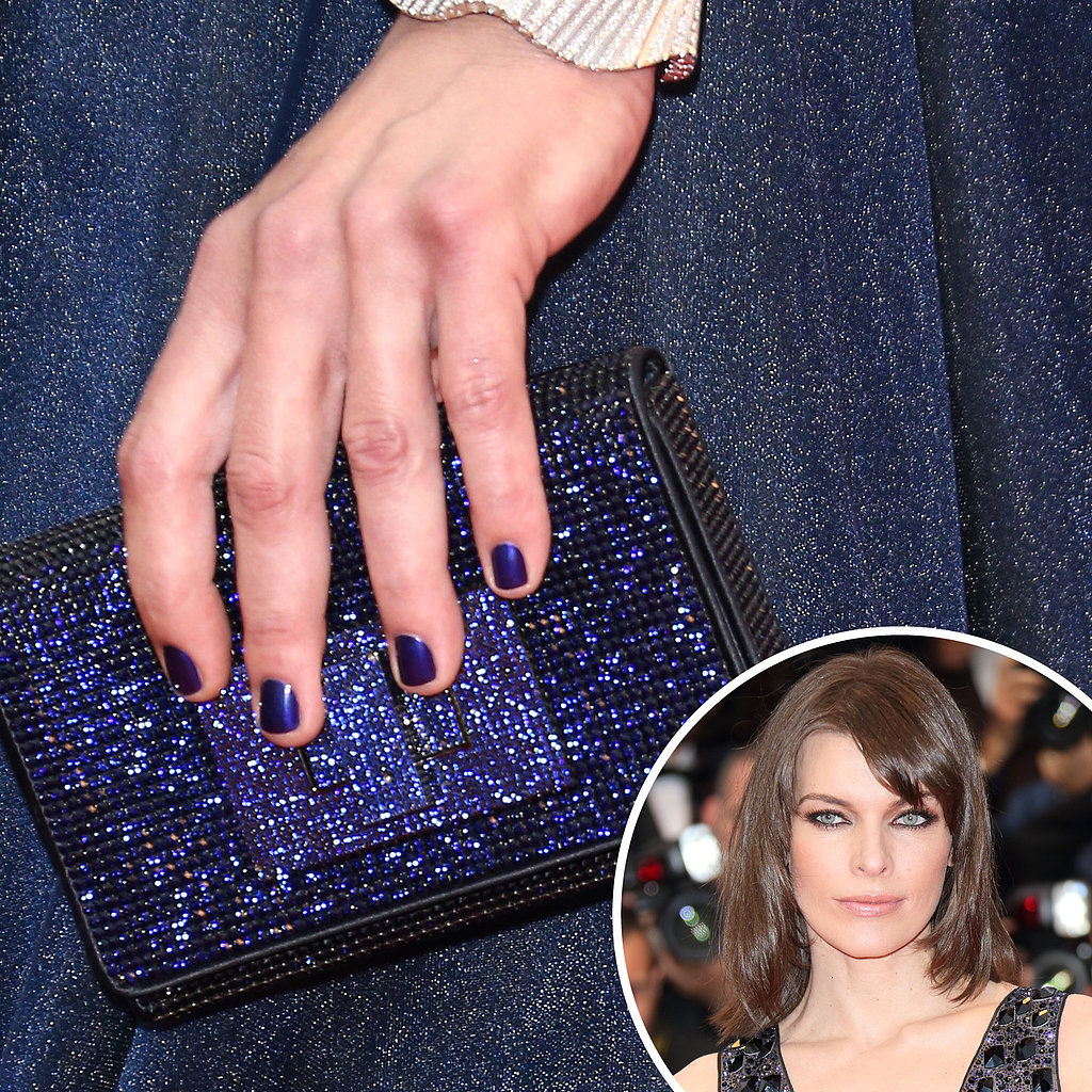 Navy and sparkly, Milla Jovovich kept her nails, purse, and dress all in the same blue color family.