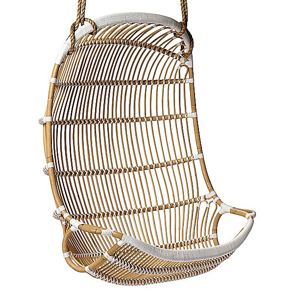 While this weather-resistant Double Hanging Rattan Chair ($695) is equipped to handle the outdoors, we're tempted to bring it inside too.