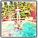 Cat Deeley showed off her cheerleading skills in the pool with some pals.