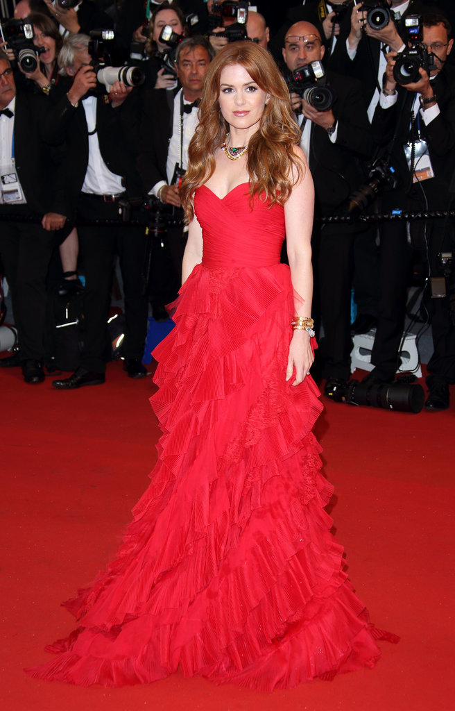 Isla Fisher had a bold moment in her red ruffled Oscar de la Renta gown and a colorful necklace at the Cannes premiere of The Great Gatsby.