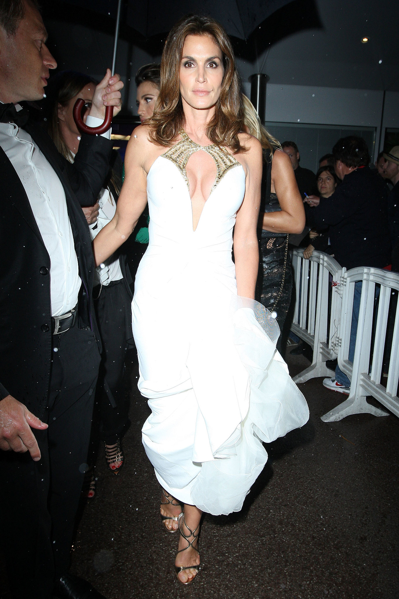 Cindy Crawford brought sexy to the Great Gatsby premiere in Cannes in a white Roberto Cavalli cutout gown with a contrasting gold neckline.