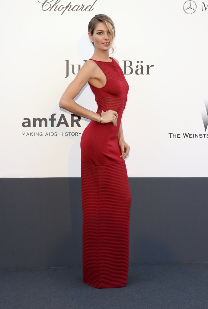 Jessica Hart struck a pose in a red formfitting gown at amfAR's gala.