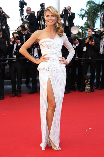Heidi Klum took a fresh futuristic approach in a white studded one-shouldered Versace gown at the Nebraska premiere.