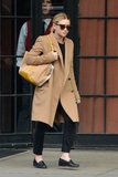 Own a classic camel coat? Well, you should. Ashley Olsen shows us why.