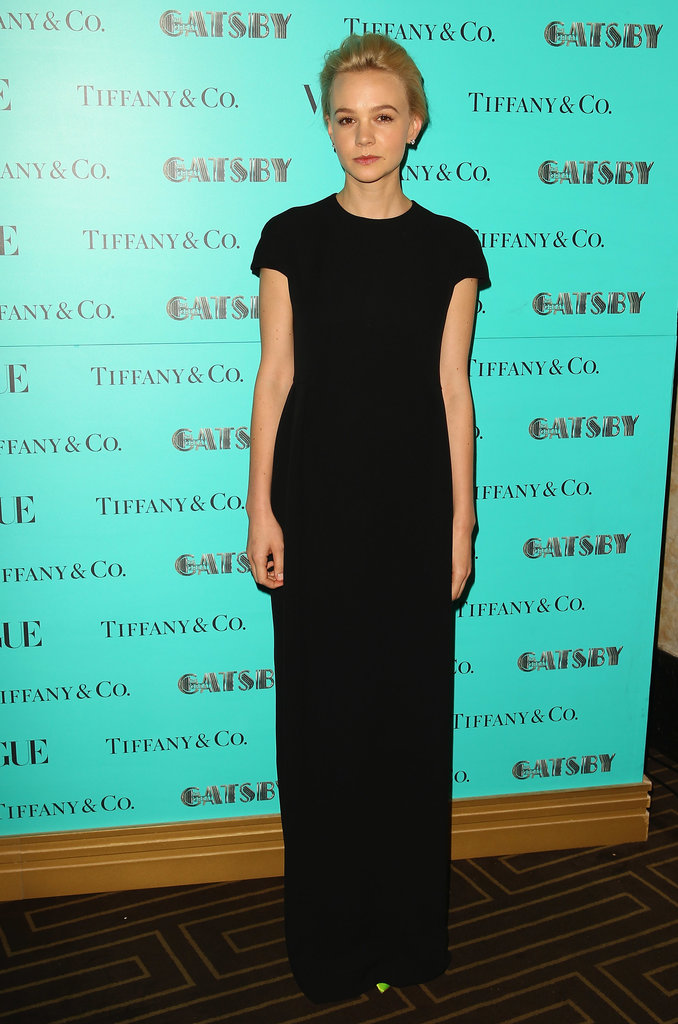 Carey Mulligan kept herself minimal in a black short-sleeved Dior gown and little else at a Great Gatsby dinner in Sydney.