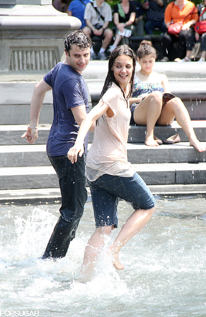 Katie Holmes and Luke Kirby splashed around in a fountain in Washington Square Park on Tuesday in NYC.