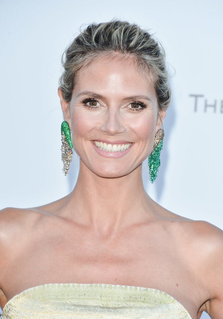 Heidi Klum wore sparkling green crystal earrings.