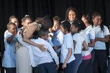 Michelle Obama hugged the students.