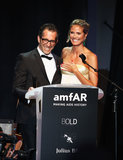 Heidi Klum and Kenneth Cole took the stage at Cannes's annual amfAR gala on Thursday.
