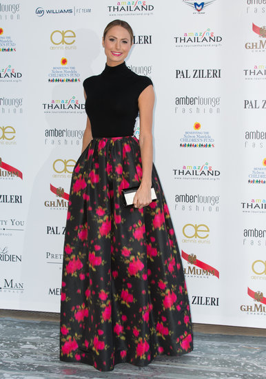 Stacy Keibler made her own red carpet moment, pairing a black knit top and ball skirt, both from Michael Kors's pre-Fall 2013 collection.