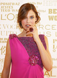 Model Bianca Balti paired a bright pink dress with a cool-toned gray nail polish at the L'Oréal Cocktail Reception.