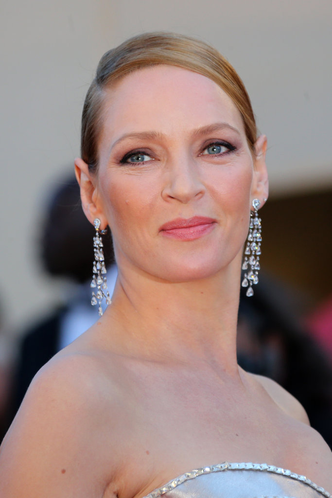 Formal brides can pull off Uma Thurman's sophisticated makeup look, consisting of a subtle smoky eye and petal-pink lips.