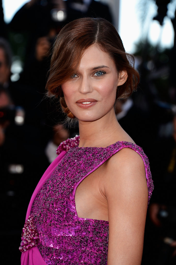 Model Bianca Balti wore a dishevelled up 'do with a soft and neutral palette on her eyes, cheeks and lips.