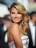Heidi Klum looked ever so glamourous with her side-parted look with large bouncy curls.
