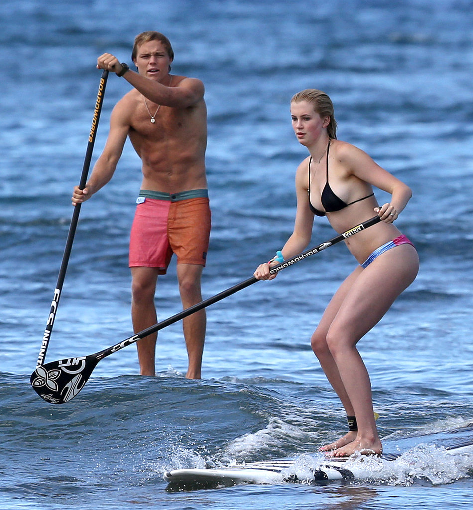 Alec Baldwin's daughter, Ireland, went paddleboarding with a friend in Hawaii on Sunday.