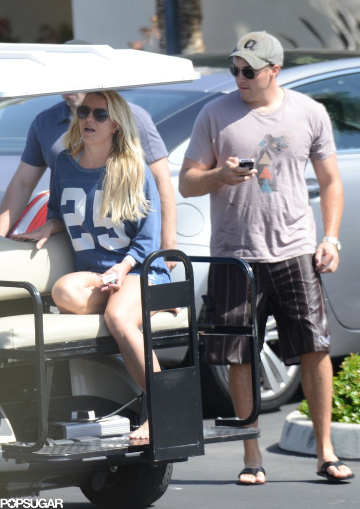 Britney Spears and David Lucado rode a golf cart around the resort.