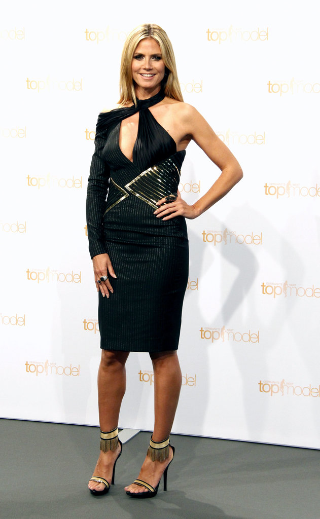 For a 2013 German's Next Top Model photocall, Heidi put her sculpted arms on display in a pinstripe and embellished Atelier Versace number, then slipped on a pair of fringed Versace sandals and a few cocktail rings for added sparkle.