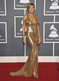 Klum showed off her flawless figure in a slinky gold Julien Macdonald gown at the 2011 Grammy Awards. In true Heidi fashion, the gown featured cutout shoulders, a plunging neckline, and sexy slit.
