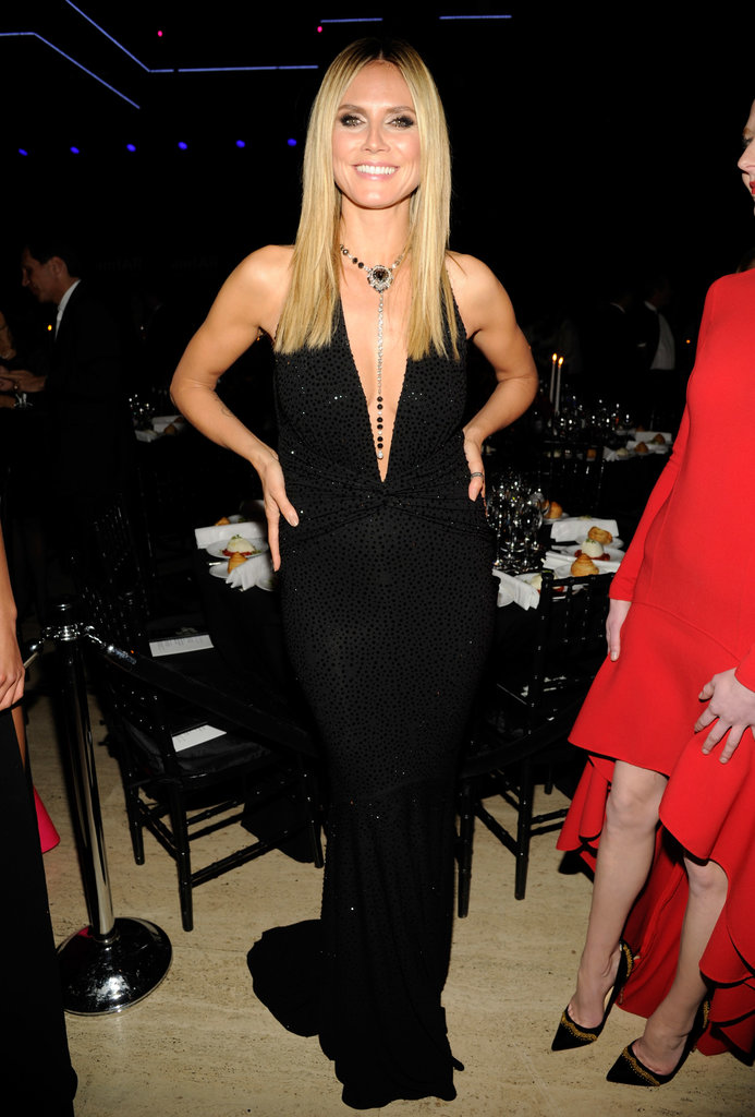 Heidi Klum styled a dangerously low Michael Kors sequined gown with a few dazzling accessories for the 2013 amfAR Gala in NYC.