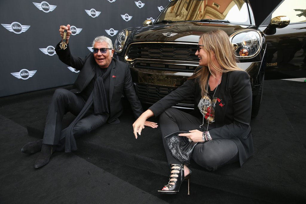 Roberto and Eva Cavalli with a Mini Cooper he designed to be auctioned to raise money for AIDS charities. Photo courtesy of Roberto Cavalli