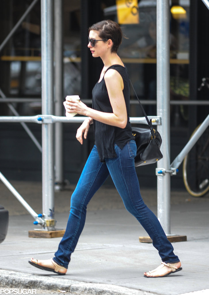 Anne Hathaway wore skinny jeans and sandals.