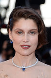 Laetitia Casta wore a diamond and sapphire statement necklace.