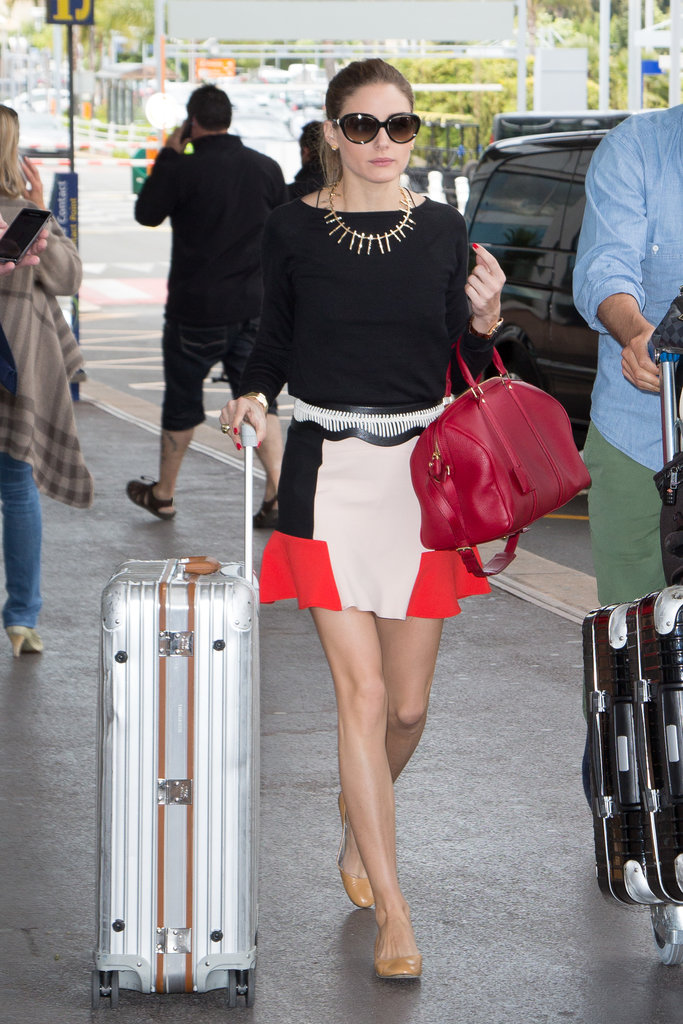 Olivia Palermo proved that heading to the airport is no reason to sacrifice style. The fashion pro brought the colorblocking trend to the jetway with a Zara skirt, finishing it off with a statement necklace and sensible flats.