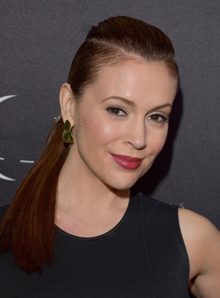 One way to elevate a simple style is to add a geometric part like Alyssa Milano. The triangular lines give the style a futuristic feeling.