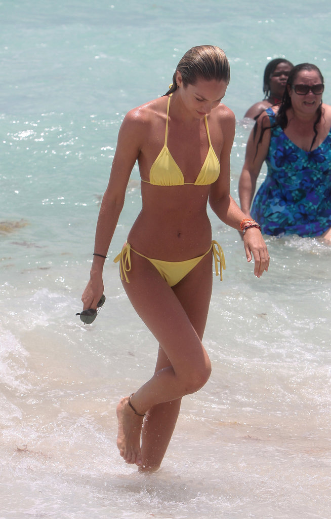 Candice Swanepoel hit the beach in Miami wearing a tiny yellow bikini in May 2013.