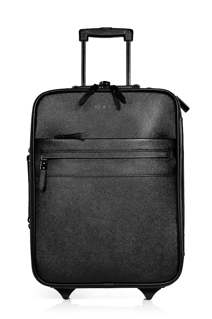 Rich, textured leather makes Burberry's suitcase ($2,410) stand out from all the other black options out there.