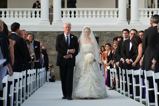 At her August 2010 wedding, Chelsea Clinton had two Vera Wang dresses. For the walk down the aisle, the bride chose a strapless ivory dress with a laser-cut organza ball-gown skirt that was finished with a silver embroidered waistband.