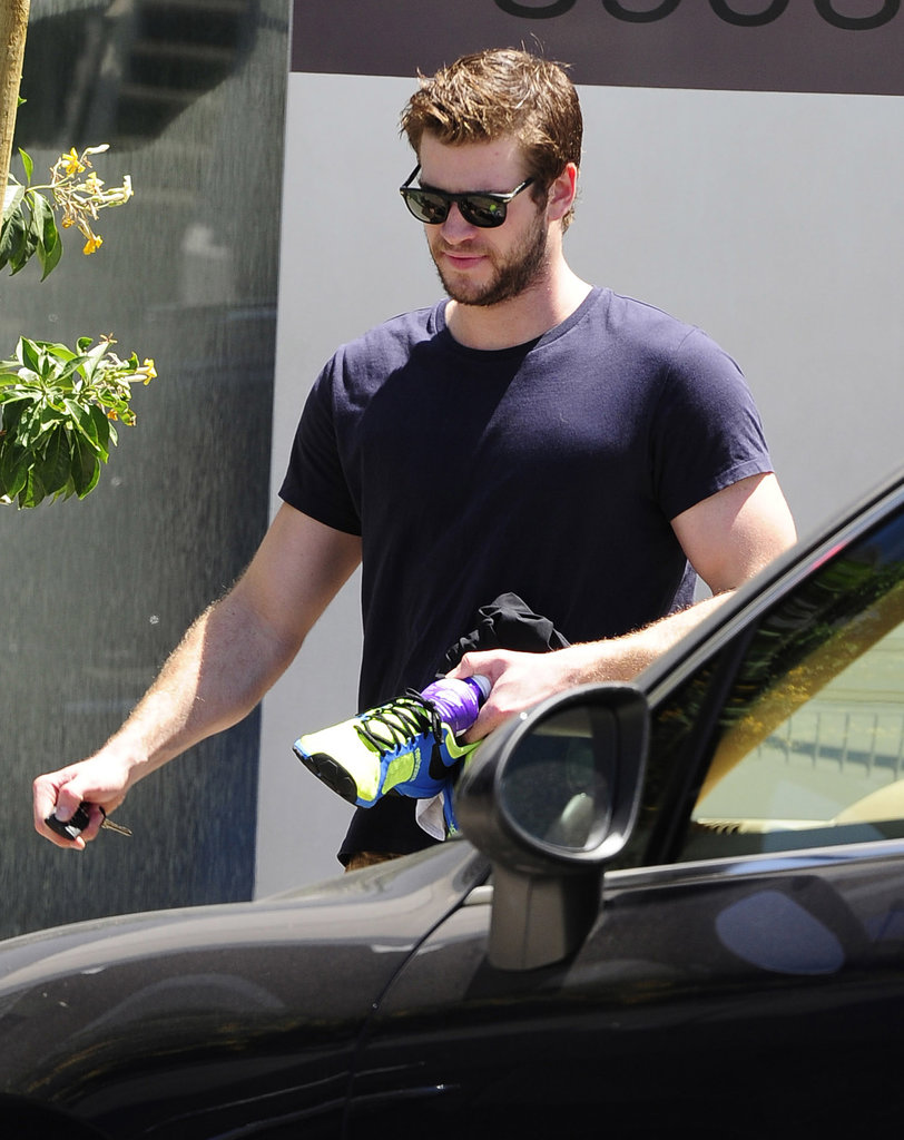 Liam Hemsworth carried running shoes in LA after rumors that his engagement to Miley Cyrus is off.