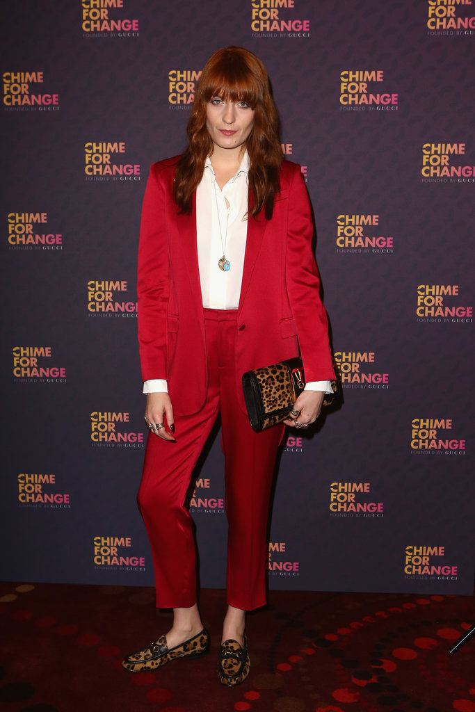 Florence Welch changed into a more comfortable (and bright) red Gucci suit after her teal onstage ensemble. We love the pops of leopard.