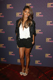 Jada Pinkett Smith put her toned legs on display in black shorts and a cool beaded jacket, all by Gucci.