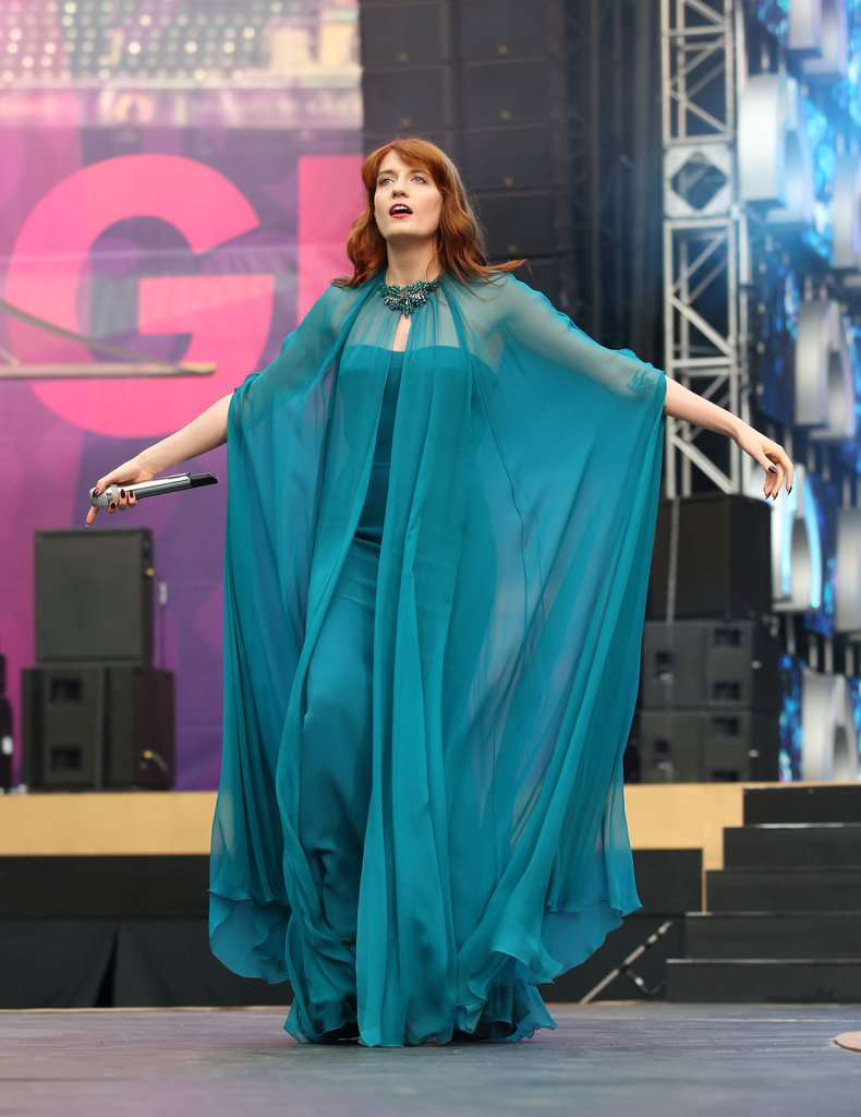 Florence Welch commanded attention in a sheer teal Gucci ensemble that set off her fiery tresses flawlessly.