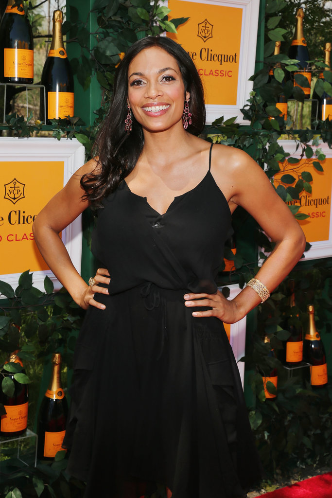 Rosario Dawson wore a black frock, H. Stern earrings, a Coomi bracelet, and a Carla Amorim ring.