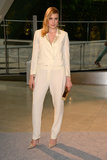 Greta Gerwig took the menswear route in an ivory tuxedo jumpsuit by Band of Outsiders and Christian Louboutin pumps.