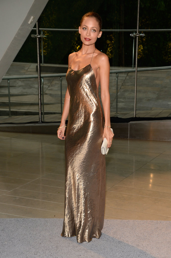 Nicole Richie was a golden girl in a metallic slip dress by Marc Jacobs Collection and a Christian Louboutin clutch.