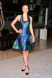 Miranda Kerr's blue eyes popped thanks to her vivid blue and green fit-and-flare printed Proenza Schouler dress, which she completed with a silver clutch and black pumps, both by Stuart Weitzman.