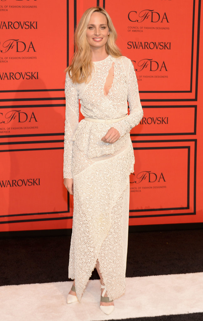 Lauren Santo Domingo covered up in an off-white gown and showed just a sliver of skin.