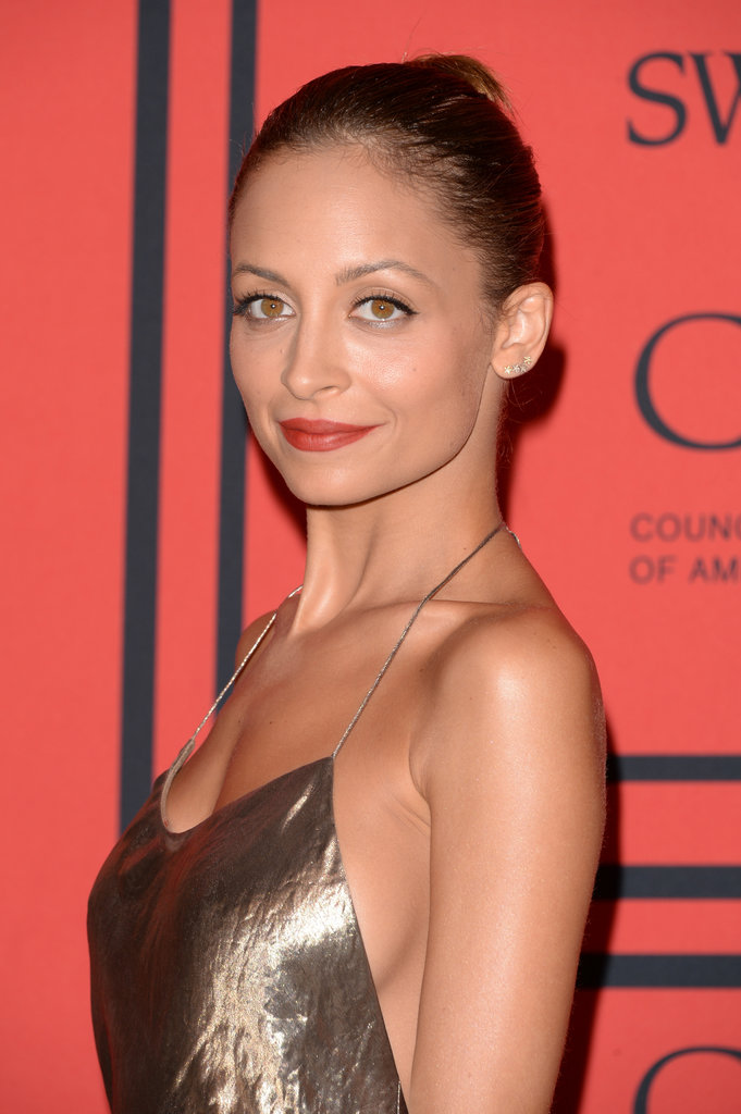 A brick-red lipstick added a hint of color to an otherwise golden palette for Nicole Richie.