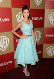 Dobrev channeled her inner prima-ballerina in an floral-embroidered Oscar de la Renta tea dress, metallic Jimmy Choo platforms, and a sweet bun for the Warner Bros. and InStyle Golden Globes after party in January 2013.