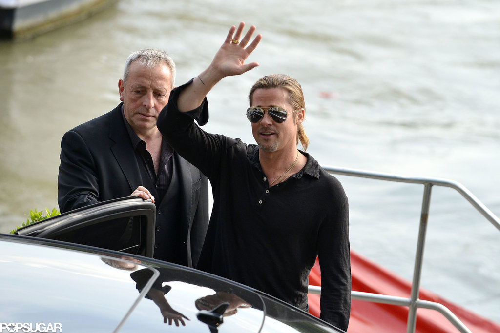 Brad Pitt waved and smiled in Paris while promoting World War Z.