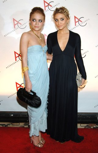 Twinning combo: The girls beat the Winter blues in brilliant coordinating gowns at the 2005 ACE Awards in NYC.  Mary-Kate lightened up the red carpet in a baby-blue strapless number, strappy gold sandals, and a few matching jewels. Ashley let her plunging navy gown do all the talking, accessorizing with only a sequined clutch.