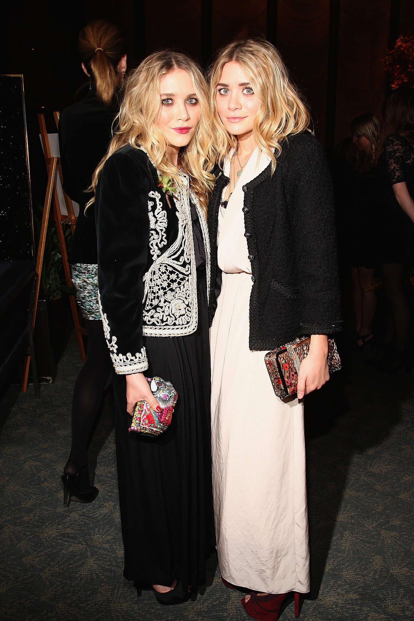 Twinning combo: At the 2009 CFDA new members reception, the darling duo polished their gorgeous gowns with ornate jackets.  Mary-Kate topped her black gown with a velour brocade jacket and colorful miniclutch. Ashley contrasted her cream-colored crepe gown with a black tweed jacket and burgundy platforms.
